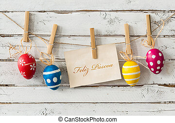 Have a peaceful easter! - Decorative easter eggs hanging on...