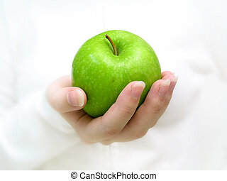 Have an apple 2 - Close up front profile of a woman holding...