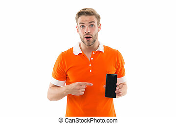 Have you seen this. Surprised man pointing at smartphone isolated on white. Pointing gesture. Index finger pointing. Pointing for advertising. Shop for clever new device. Go digital