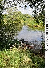 Havel river at summer time (Brandenburg, Germany). boats on shore
