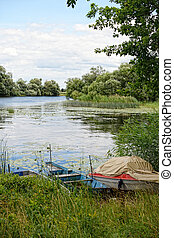 Havel river at summer time (Brandenburg, Germany). boats on shore