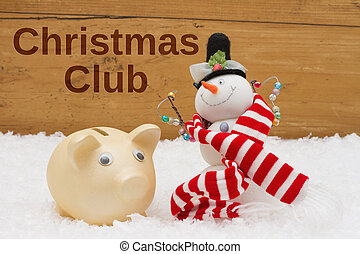 Having a Christmas Club Savings Plan, Piggy bank and snowman with scarf on snow