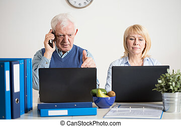 Having a company - Two elderly people having their own...