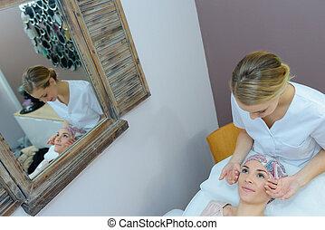 having a facial treatment