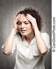 having a headache - woman having a headache