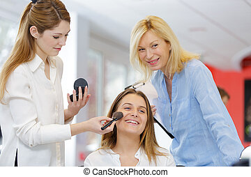 having a make-up in the salon