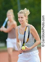 having a tennis lesson