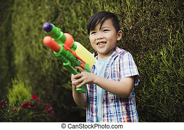 Having a Water Fight in the Garden