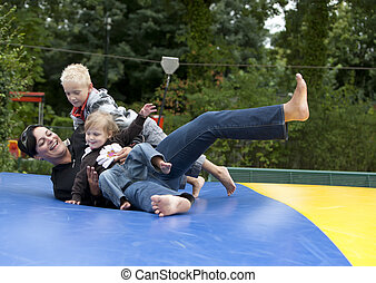 Having fun - Family is having fun in the playground.