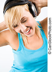 Having fun - Image of modern teenage girl wearing headphones...