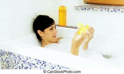 Having fun in bath tub playing