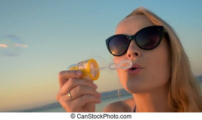 Having fun on vacation with blowing bubbles