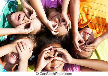 Having fun - Portrait of happy preschoolers lying and...