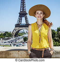 smiling young woman in bright blouse in Paris, France -...