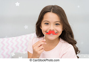 Having fun with face mustache. Happy small girl. Small girl hold fake mustache on face. Happy childhood. My childhood is amazing