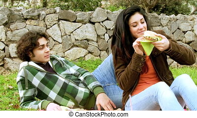 Having fun with hamburger in park