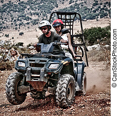 Having fun with sand buggy - Young couple riding sand buggy...