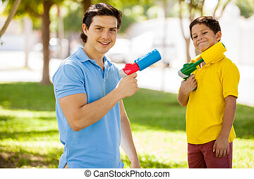 Having fun with water guns