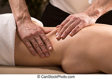 Having lower back massage
