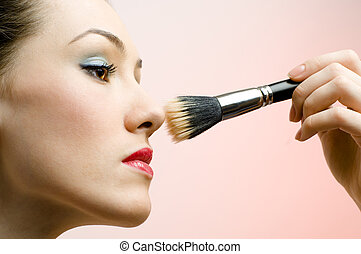 having make-up - portrait of pretty girl having make-up