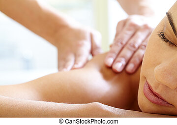 Having massage - Part of face of calm female during ...