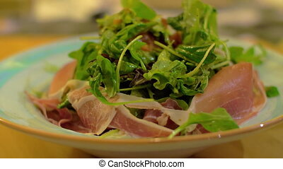 Having meal with salad at the restaurant - Close-up shot of...