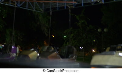 Having ride in bumper car at fun fair, speed-up - Speed-up ...