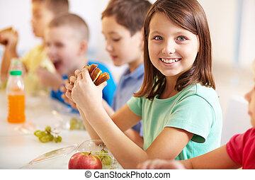 Having snack - Group of classmates having lunch during break...