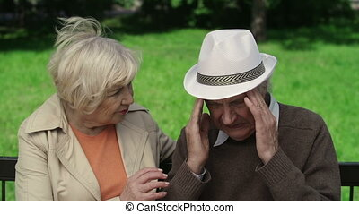 Having the Pip - Close up of elderly woman preoccupied with...
