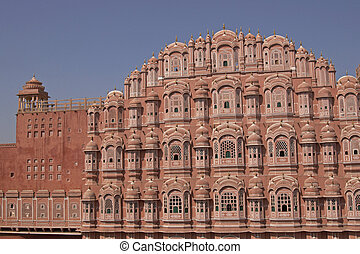 Hawa Mahal or Palace of the Winds. Ornate pink facade built...