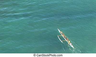 Hawaii outrigger - Hawaiian outrigger canoe paddling across...