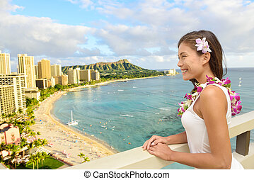 Hawaii Travel - Tourist looking at Waikiki beach