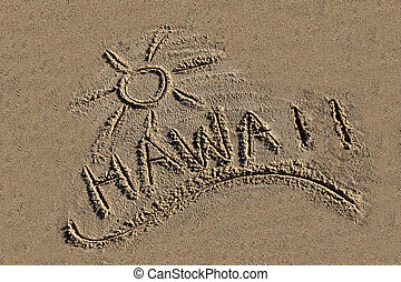 Hawaii written in the sand at the beach