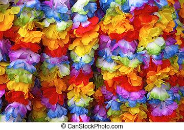 Hawaiian garlands - Several hawaiian garlands hanging one...