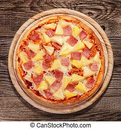 Hawaiian pizza on the old table