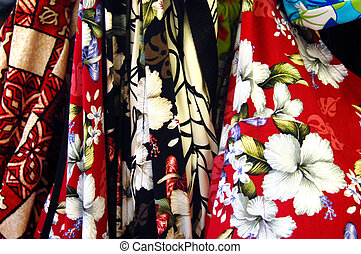 Hawaiian Shirts - Brightly colored fabrics depict hibiscus...