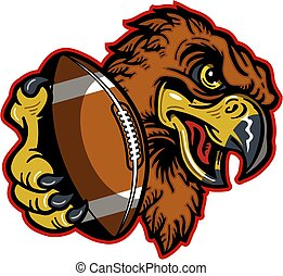 hawks football mascot holding ball in claw for school,...
