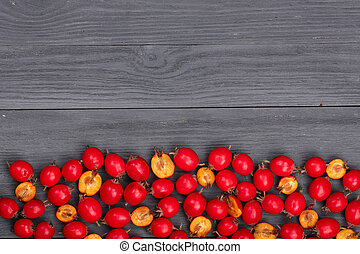 Hawthorn berry on a black wooden background with copy space for your text. Top view