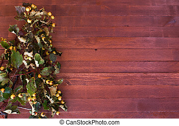 Hawthorn twigs on a wooden with copy space