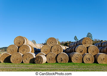 Hay Bails in Pyramids - Multiple hay bails arranged in...