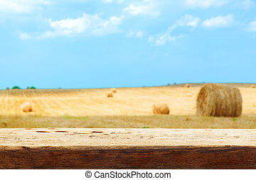 hay bale field blur tabletop wooden background shallow DOF