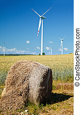 hay bale with wind turbines
