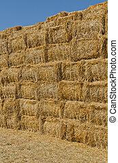 hay bales  - a stack of hay bales, vertical shot