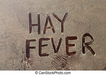 Hay fever text over yellow pollen grains on the background.