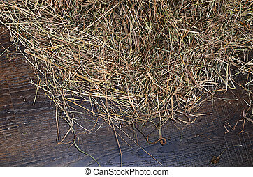Hay on a wooden background