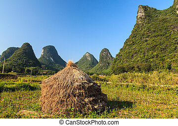 Hay stack on the land in a rocky hill landscape