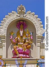 FEBRUARY 1, 2015, TIRUMALA, ANDHRA PRADESH, INDIA - Sculpture of Hayagriva, the horse incarnation of Vishnu, with his consort Lakshmi on the wall of the temple