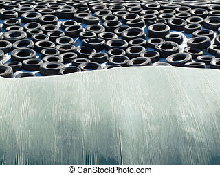 Haylage bales and covered silage under car tyres - Silage or...