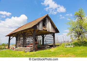 Hayrack and barn in Alpine enviroment, Slovenia -...