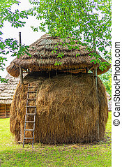 Haystack in the countryside. Hay making. - Large haystack in...